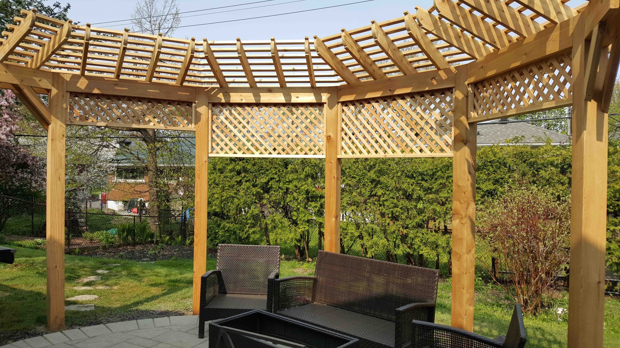 wooden pergola in center of backyard